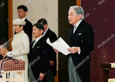 Japan's Emperor Akihito speaks during the ceremony of his abdication in front of other members of the royal families and top government officials at the Imperial Palace in Tokyo, . The 85-year-old Akihito ends his three-decade reign on Tuesday as his son Crown Prince Naruhito, second from left, will ascend the Chrysanthemum throne on Wednesday. Crown Princess Masako is at left