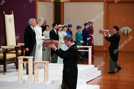 Japan's Emperor Akihito, left, accompanied by Empress Michiko, attends the ceremony of his abdication in front of other members of the royal families and top government officials at the Imperial Palace in Tokyo, . The 85-year-old Akihito ends his three-decade reign on Tuesday as his son Crown Prince Naruhito will ascend the Chrysanthemum throne on Wednesday