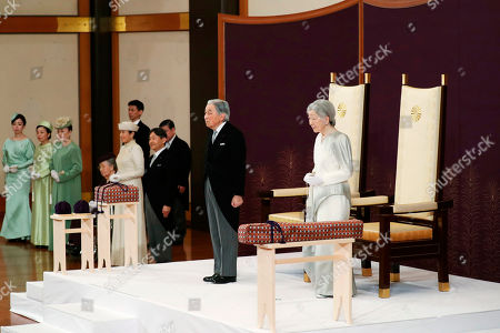 Japan's Emperor Akihito, second from right, accompanied by Empress Michiko, attends the ceremony of his abdication in front of other members of the royal families and top government officials at the Imperial Palace in Tokyo, . The 85-year-old Akihito ends his three-decade reign on Tuesday as his son Crown Prince Naruhito will ascend the Chrysanthemum throne on Wednesday