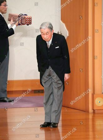 Japan's Emperor Akihito bows before leaving after the ceremony of his abdication in front of other members of the royal families and top government officials at the Imperial Palace in Tokyo, . The 85-year-old Akihito ends his three-decade reign on Tuesday as his son Crown Prince Naruhito will ascend the Chrysanthemum throne on Wednesday