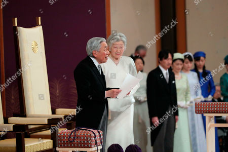 Japan's Emperor Akihito, watched by Empress Michiko, speaks during the ceremony of his abdication in front of other members of the royal families and top government officials at the Imperial Palace in Tokyo, . The 85-year-old Akihito ends his three-decade reign on Tuesday as his son Crown Prince Naruhito will ascend the Chrysanthemum throne on Wednesday
