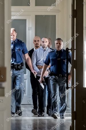 The two accused, Arash Nahvi (2-R) and Armin Nahvi (2-L) are escorted by police for court proceedings at the Municipal Court in Prague, Czech Republic, 30 April 2019. The prosecutor accuses the two Dutch men, who were part of a group of seven, of attempted murder. Seven Dutch men were arrested for assaulting a waiter in Prague on 21 April 2018. Media reported that the men were caught on CCTV video attacking a waiter, who told them they could not drink their own alcohol on the cafe terrace. The assaulted waiter was in intensive care in hospital, where he was treated with brain hemorrhage, broken facial bones and injured eye.