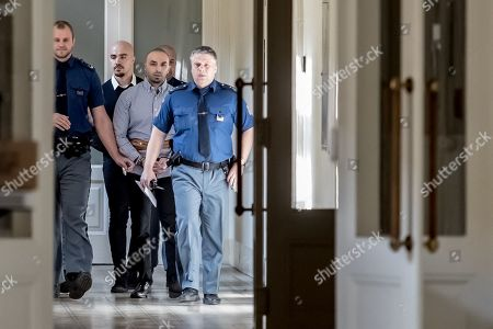 The two accused, Arash Nahvi (3-R) and Armin Nahvi (2-L) are escorted by police for court proceedings at the Municipal Court in Prague, Czech Republic, 30 April 2019. The prosecutor accuses the two Dutch men, who were part of a group of seven, of attempted murder. Seven Dutch men were arrested for assaulting a waiter in Prague on 21 April 2018. Media reported that the men were caught on CCTV video attacking a waiter, who told them they could not drink their own alcohol on the cafe terrace. The assaulted waiter was in intensive care in hospital, where he was treated with brain hemorrhage, broken facial bones and injured eye.