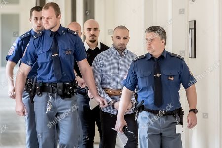 The two accused, Arash Nahvi (2-R) and Armin Nahvi (3-R) are escorted by police for court proceedings at the Municipal Court in Prague, Czech Republic, 30 April 2019. The prosecutor accuses the two Dutch men, who were part of a group of seven, of attempted murder. Seven Dutch men were arrested for assaulting a waiter in Prague on 21 April 2018. Media reported that the men were caught on CCTV video attacking a waiter, who told them they could not drink their own alcohol on the cafe terrace. The assaulted waiter was in intensive care in hospital, where he was treated with brain hemorrhage, broken facial bones and injured eye.