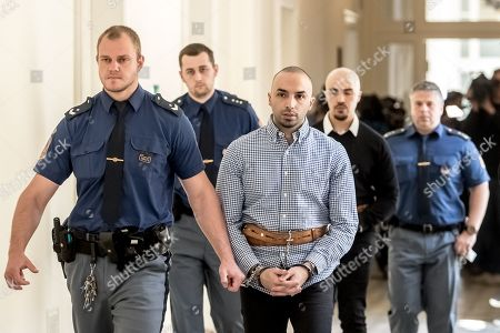 The two accused, Arash Nahvi (3-R) and Armin Nahvi (2-R) are escorted by police from court proceedings at the Municipal Court in Prague, Czech Republic, 30 April 2019. The prosecutor accuses the two Dutch men, who were part of a group of seven, of attempted murder. Seven Dutch men were arrested for assaulting a waiter in Prague on 21 April 2018. Media reported that the men were caught on CCTV video attacking a waiter, who told them they could not drink their own alcohol on the cafe terrace. The assaulted waiter was in intensive care in hospital, where he was treated with brain hemorrhage, broken facial bones and injured eye.