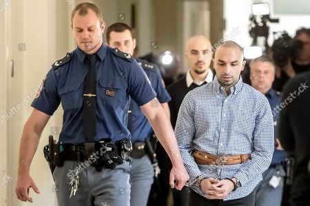 The two accused, Arash Nahvi (R) and Armin Nahvi (2-R) are escorted by police from court proceedings at the Municipal Court in Prague, Czech Republic, 30 April 2019. The prosecutor accuses the two Dutch men, who were part of a group of seven, of attempted murder. Seven Dutch men were arrested for assaulting a waiter in Prague on 21 April 2018. Media reported that the men were caught on CCTV video attacking a waiter, who told them they could not drink their own alcohol on the cafe terrace. The assaulted waiter was in intensive care in hospital, where he was treated with brain hemorrhage, broken facial bones and injured eye.