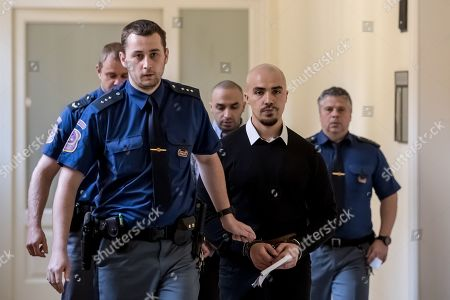 The two accused Arash Nahvi (3-R) and Armin Nahvi (2-R) are escorted by police for court proceedings at the Municipal Court in Prague, Czech Republic, 30 April 2019. The prosecutor accuses the two Dutch men, who were part of a group of seven, of attempted murder. Seven Dutch men were arrested for assaulting a waiter in Prague on 21 April 2018. Media reported that the men were caught on CCTV video attacking a waiter, who told them they could not drink their own alcohol on the cafe terrace. The assaulted waiter was in intensive care in hospital, where he was treated with brain hemorrhage, broken facial bones and injured eye.