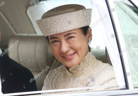 Stock Photo of Crown Princess Masako, with Crown Prince Naruhito, arrives at the Imperial Palace to attend the ceremony of Emperor Akihito's abdication in Tokyo, . Emperor Akihito announced his abdication at a palace ceremony Tuesday in his final address, as the nation embraced the end of his reign with reminiscence and hope for a new era