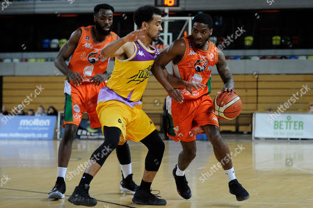 Justin Robinson of London Lions and Devontavius Payne of Plymouth Raiders in action during the Benecos British Basketball League Playoffs Quarter-Finals match between London Lions and Plymouth Raiders at the Copper Box Arena in London, UK - 6th May 2019