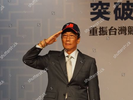 Terry Gou, chairman of Taiwan's Hon Hai Group and candidate in the 2020 presidential election, salutes the audience at an economic forum in Taipei, Taiwan, 30 April 2019. Several people, including President Tsai Ing-wen and Gou, have expressed the wish to join the January 2020 race but the ruling Democfratic Progressive Party (DPP) and the main opposition Chinese Nationalist Party (KMT) have not announced their candidates yet.