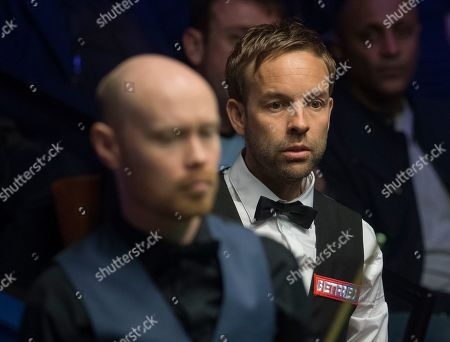 Ali Carter of England at the table during his quarter final match