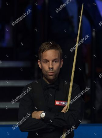 Stock Photo of Ali Carter of England at the table during his quarter final match