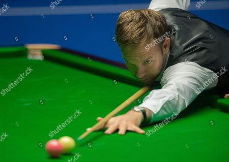 Stock Picture of Ali Carter of England at the table during his quarter final match