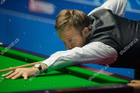 Stock Image of Ali Carter of England at the table during his quarter final match