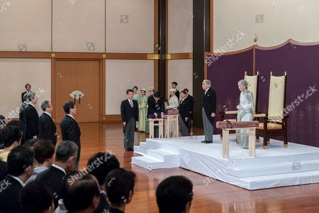 Japan's Emperor Akihito, left, accompanied by Empress Michiko, attends the ceremony of his abdication in front of other members of the royal families and top government officials at the Imperial Palace, in Tokyo