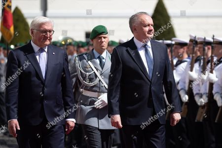 German President Frank-Walter Steinmeier (L) accompanies visiting President of the Slovak Republic, Andrej Kiska (R) as they inspect a guard of honor during an official welcoming ceremony outside the Bellevue Palace residence of the German president, in Berlin, Germany, 30 April 2019.