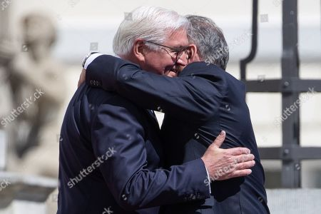 German President Frank-Walter Steinmeier (L) hugs visiting President of the Slovak Republic, Andrej Kiska (R) as they inspect a guard of honor during an official welcoming ceremony outside the Bellevue Palace residence of the German president, in Berlin, Germany, 30 April 2019.
