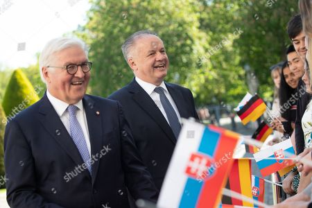 German President Frank-Walter Steinmeier (L) and visiting President of the Slovak Republic, Andrej Kiska (R) talk to the guests during an official welcoming ceremony outside the Bellevue Palace residence of the German president, in Berlin, Germany, 30 April 2019.