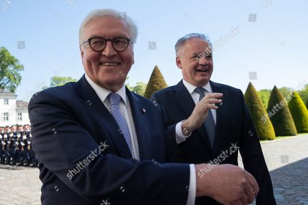 German President Frank-Walter Steinmeier (L) and visiting President of the Slovak Republic, Andrej Kiska (R) talk to the guests as they inspect a guard of honor during an official welcoming ceremony outside the Bellevue Palace residence of the German president, in Berlin, Germany, 30 April 2019.