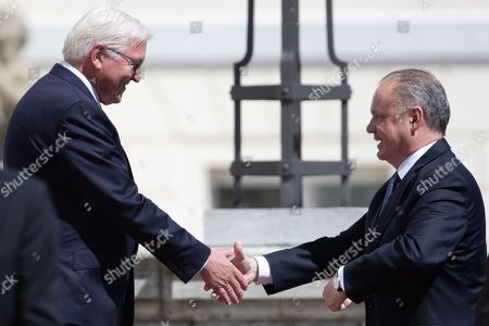 German President Frank-Walter Steinmeier (L) shakes hands with visiting President of the Slovak Republic, Andrej Kiska (R) during an official welcoming ceremony outside the Bellevue Palace residence of the German president, in Berlin, Germany, 30 April 2019.