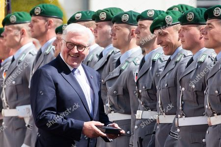 German President Frank-Walter Steinmeier (L) gives a present to a soldier during an official welcoming ceremony outside the Bellevue Palace residence of the German president, in Berlin, Germany, 30 April 2019. The President of the Slovak Republic Andrej Kiska visits the German capital.