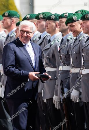 Stock Image of German President Frank-Walter Steinmeier (L) gives a present to a soldier during an official welcoming ceremony outside the Bellevue Palace residence of the German president, in Berlin, Germany, 30 April 2019. The President of the Slovak Republic Andrej Kiska visits the German capital.