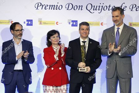 King Felipe VI of Spain (L) hands in the Don Quijote Journalism Award to Spanish professor of Spanish Language Francisco Moreno (2R) next to acting deputy Prime Minster, Carmen Calvo (2L), and President of Efe news agency, Fernando Garea (L), at the awarding ceremony of the King of Spain Journalism Awards held in Madrid, Spain, 30 April 2019. The awards, organized by Efe news agency and the Spanish Agency for International Development Cooperation (AECID), distinguishes the work of journalists from different countries.