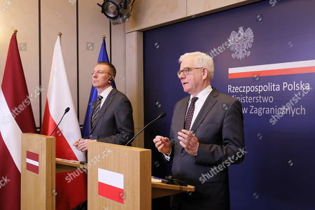 Polish Foreign Minister Jacek Czaputowicz (R) and Latvian Foreign Minister Edgars Rinkevics (L) attend a press conference after their meeting in Warsaw, Poland, 30 April 2019.