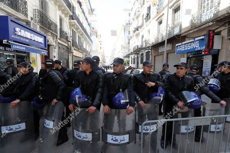 Algerian policemen block the way front of protesters against Former Algerian Prime Minister Ahmed Ouyahia in front of the court of justice in Algiers, Algeria, 30 April 2019.  According to media reports, Ouyahia was questioned today in a widening investigation into alleged corruption in the inner circle of ousted president Abdelaziz Bouteflika.