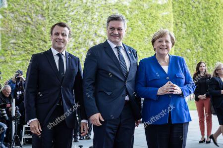 German Chancellor Angela Merkel and French President Emmanuel Macron welcome Bosnia and Herzegovina's Prime Minister Denis Zvizdic