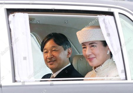 Japan's Crown Prince Naruhito (L) and Crown Princess Masako leave the Imperial Palace in Tokyo
