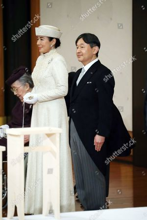Stock Photo of Japan's Crown Prince Naruhito (R) and Crown Princess Masako (L) attend Emperor Akihito's 'Taiirei-Seiden-no-gi', a ceremony where the Emperor made his last public declaration before his abdication at the Seiden (State Hall) of the Imperial Palace in Tokyo, Japan