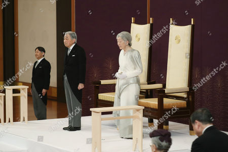 Japan's Emperor Akihito (C-L) and Empress Michiko (C) attend the 'Taiirei-Seiden-no-gi', a ceremony where the Emperor made his last public declaration before his abdication at the Seiden (State Hall) of the Imperial Palace in Tokyo, Japan