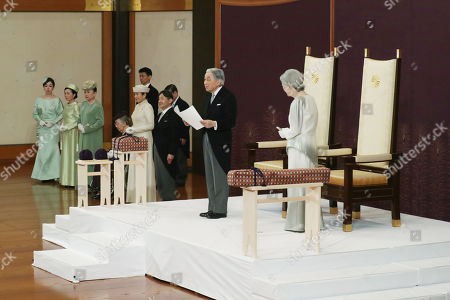 Japan's Emperor Akihito (2-R) and Empress Michiko (R) attend the 'Taiirei-Seiden-no-gi', a ceremony where the Emperor made his last public declaration before his abdication at the Seiden (State Hall) of the Imperial Palace in Tokyo, Japan