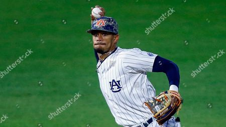 Auburn shortstop Will Holland throws to first during an NCAA college baseball game against Ole Miss, in Auburn, Ala