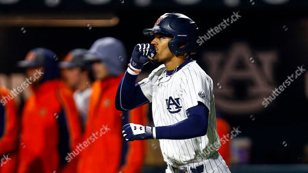 Auburn's Will Holland celebrates a hitting a homer during an NCAA college baseball game against Ole Miss, in Auburn, Ala