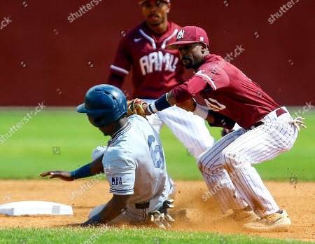 Alabama A&M shortstop Jonathan Smith (2) tags Jackson State's Chandler Dillard (6) out as he steals second during an NCAA college baseball game, in Huntsville, Ala