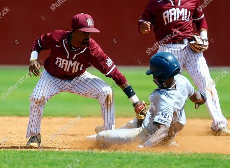 Jackson State's Chris Prentiss (4) is tagged out by Alabama A&M shortstop Jonathan Smith (2) as he slides into second during an NCAA college baseball game, in Huntsville, Ala