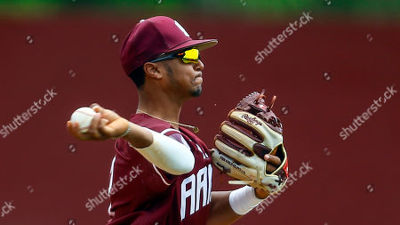 Alabama A&M shortstop Jonathan Smith throws to first during an NCAA college baseball game against Jackson State, in Huntsville, Ala