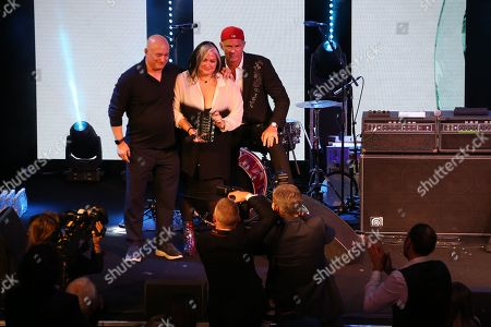 Stock Image of Peter Mensch and Chad Smith (Red Hot Chili Peppers present Emma Banks with her award