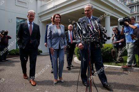 Nancy Pelosi, Chuck Schumer, Peter DeFazio, Ron Wyden, Richard Neal. Speaker of the House Nancy Pelosi of Calif., and Senate Minority Leader Sen. Chuck Schumer of N.Y., walk over to speak with reporters after meeting with President Donald Trump about infrastructure, at the White House, in Washington. From left, House Ways and Mean Committee Chairman Rep. Richard Neal, D-Mass., Sen. Ron Wyden, D-Ore., Pelosi, Chairman of the House Transportation and Infrastructure Committee Rep. Peter DeFazio, D-Ore., and Schumer