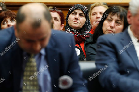 Women in the audience listen as former Kosovo President Atifete Jahjaga testifies about the victims of sexual violence during a House Foreign Affairs Committee on Kosovo's Wartime Victims, on Capitol Hill in Washington