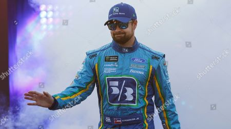 Ricky Stenhouse Jr. waves to fans during driver introductions prior to the start of the NASCAR Cup series auto race at Richmond Raceway in Richmond, Va