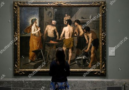 A visitor stands in front of the baroque artwork 'Forge of Vulcan' (1630) by Spanish painter Diego Velazquez (1599-1660), in the exhibition at the Prado Museum in Madrid, Spain, 30 April 2019. Prado Museum of Madrid received today the Princess of Asturias Award for Communication and Humanities, an honor that coincides with the bicentennial celebration of the picture gallery.