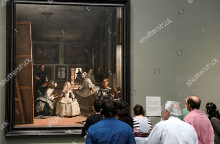 Stock Picture of Visitors stand in front of the baroque artwork 'The Maids of Honour' (1656) by Spanish painter Diego Velazquez (1599-1660), in the exhibition at the Prado Museum in Madrid, Spain, 30 April 2019. Prado Museum of Madrid received today the Princess of Asturias Award for Communication and Humanities, an honor that coincides with the bicentennial celebration of the picture gallery.