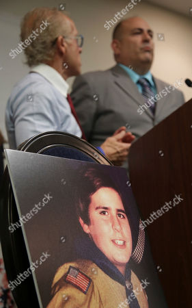 A picture of Richard Halvorson as a boy scout in 1982, when he was 11-years-old, is displayed while Halvorson, right, and attorney Jeff Anderson speak during a news conference in Newark, N.J., . Halvorson is alleging sexual abuse in a lawsuit filed against the Boy Scouts of America