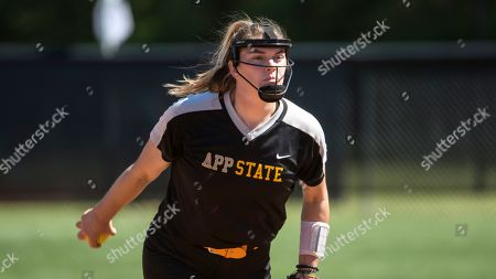 Appalachian State pitcher Sydney Holland delivers to a Presbyterian batter during an NCAA softball game on in Clinton, S.C