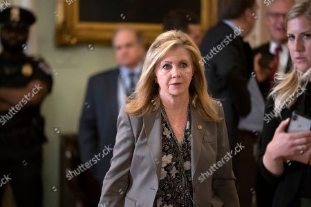 Sen. Marsha Blackburn, R-Tenn., leaves the chamber after commenting to reporters about conservative commentator Stephen Moore, President Trump choice to serve on the Federal Reserve Board, at the Capitol in Washington, . Moore has gone on a talk-show blitz to try to save his candidacy following disclosures of incendiary comments he has made in the past about women