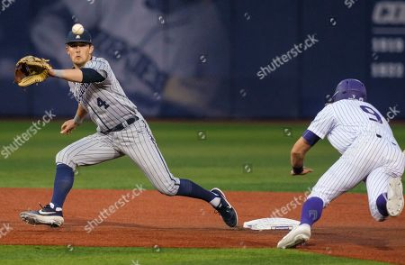 Brigham Young shortstop Jackson Cluff fields a throw as Washington's Connor Blair steals second base during an NCAA college baseball game, in Seattle