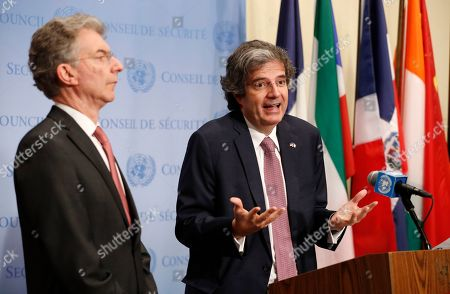Christoph Heusgen, Francois Delattre. France's United Nations Ambassador Francois Delattre, right, gestures as he stands beside Germany's United Nations Representative Christoph Heusgen following a Security Council Meeting at the U.N. headquarters